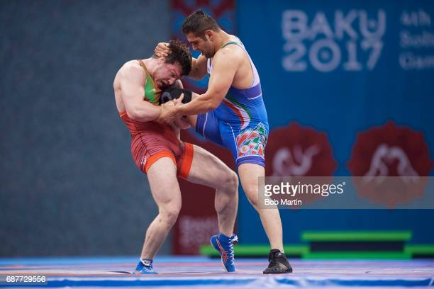 4th Islamic Solidarity Games Azerbaijan Nurmagomed Gadzhiyev in action vs Iran Amir Mohammadi during the Men's Freestyle 97 kg Gold medal match at...