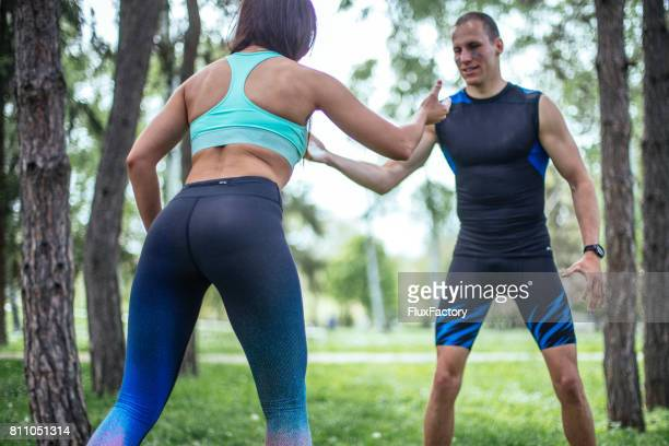 wrestling a guy and a girl - female wrestling stock photos and pictures