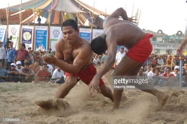 Wrestling at the popular wrestling festival 'Jabbarer Bali Khela' in Chittagong Bangladesh Jabbarer bali khela is the most popular festival of...