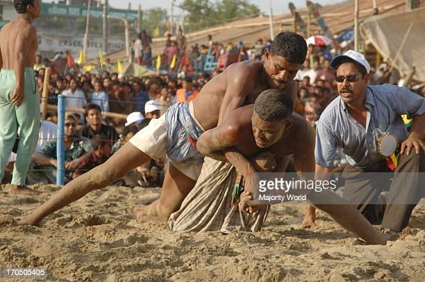 Wrestling at the popular wrestling festival 'Jabbarer Bali Khela' in Chittagong Bangladesh Jabbarer bali khela is the most popular wrestling event in...
