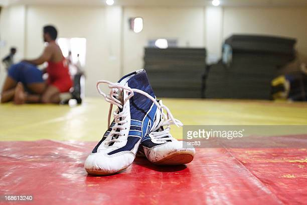 wrestling boots at the gym - wrestling stock pictures, royalty-free photos & images