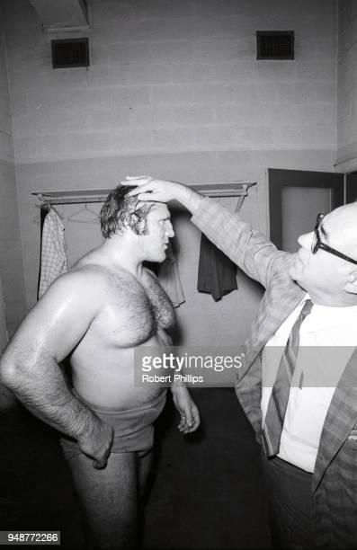 Bruno Sammartino getting injury checked by medical staff in the locker room after match vs Geeto Mongol at Civic Arena Pittsburgh PA CREDIT Robert...
