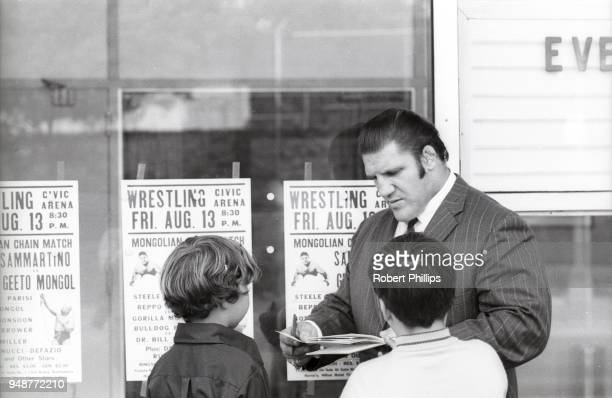 Bruno Sammartino signing autographs for children before match at the Civic Arena. Pittsburgh, PA 8/13/1971 CREDIT: Robert Phillips