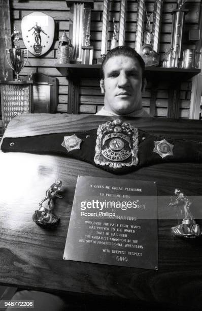 Casual portrait of Bruno Sammartino holding trophy plaque during photo shoot at home. Pittsburgh, PA 8/13/1971 -- 8/15/1971 CREDIT: Robert Phillips