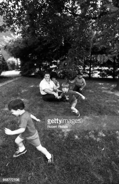 Casual portrait of Bruno Sammartino playing outside with wife Carol and sons Danny, Darryl and David Sammartino during photo shoot at home....