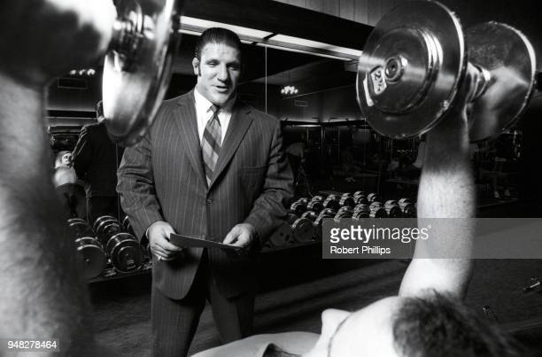 Casual portrait of Bruno Sammartino wearing suit and speaking with wrestler during photo shoot in gym. Pittsburgh, PA 8/15/1971 CREDIT: Robert...