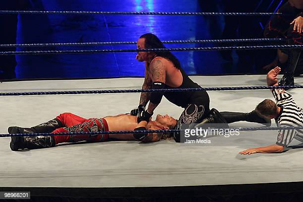 Wrestling fighters Edge and Undertaker fight during the WWE Smackdown Wrestling at Arenal Monterrey on May 9 2010 in Monterrey Mexico