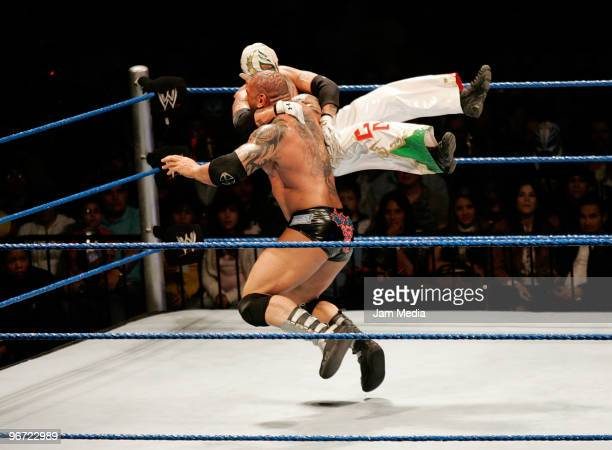 Wrestling fighters Rey Misterio and Batista fight during the WWE Smackdown wrestling function at Plaza Vicente Fernandez on February 14 2010 in...