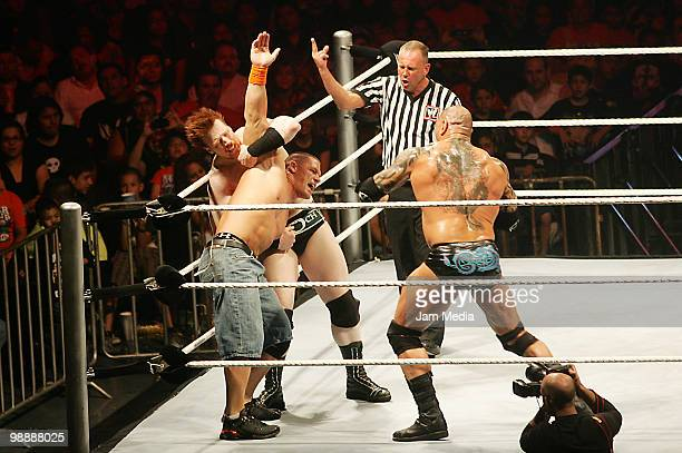 Wrestling fighters Sheanus John Cena and Batista fight during the WWE RAW wrestling function at Arena Monterrey on May 5 2010 in Monterrey Mexico
