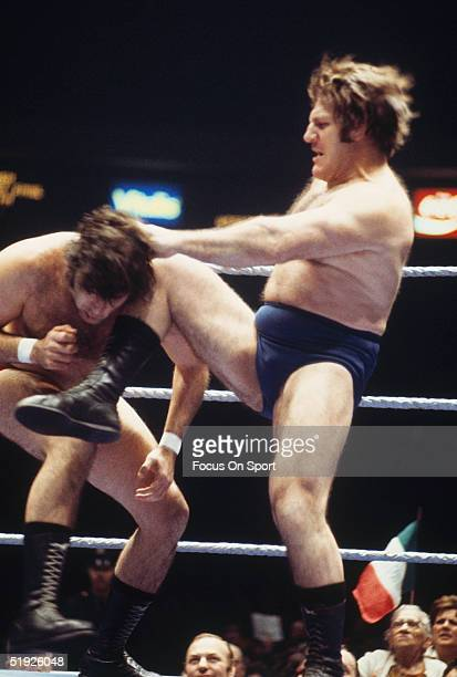Wrestling legend Bruno Sammartino makes a move against his opponent in the ring.
