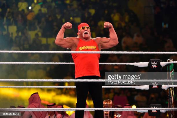Wrestling legend Hulk Hogan greets the crowd during the World Wrestling Entertainment Crown Jewel payperview at the King Saud University Stadium in...