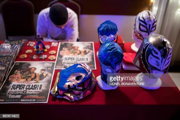 Wrestling masks for sale are pictured within a show on March 11 in Nanterre, near Paris. - In Nanterre, the French Association of Professional...