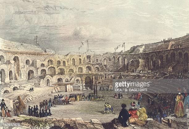 A wrestling match inside the Arena of Nimes coloured engraving France 19th century Paris Bibliothèque Des Arts Decoratifs