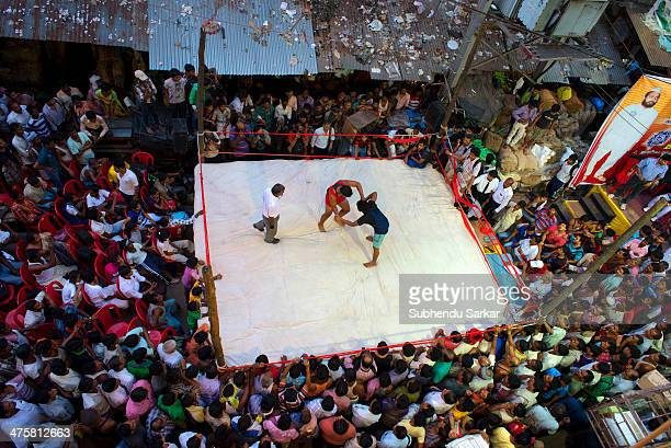 Wrestling match on a street of Kolkata, India.