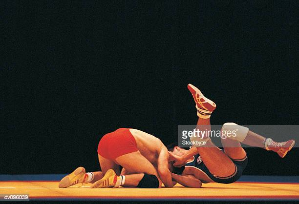 wrestling match - wrestling stock pictures, royalty-free photos & images
