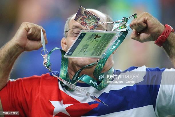 Day 11 Raul Trujillo of Cuba head coach of the GrecoRoman discipline celebrates as his fighter Yasmany Daniel Lugo Cabrera of Cuba wins his semi...
