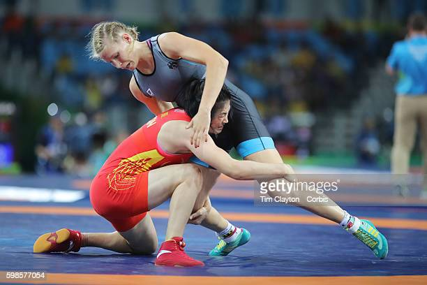 Day 12 Aline Focken of Germany in action against Feng Zhou of China during their Women's Freestyle 69 kg bout at the Carioca Arena 2 on August 17...