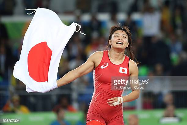 Day 12 Kaori Icho of Japan celebrates victory against Valeriia Koblova Zholobova of Russia during their Women's Freestyle 58 kg Gold Medal Final at...