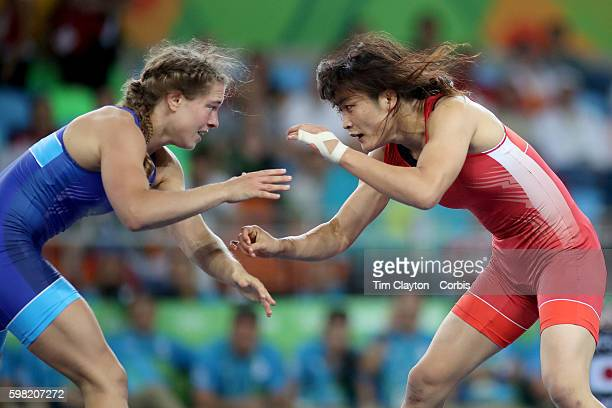 Day 12 Kaori Icho of Japan in action during her victory against Valeriia Koblova Zholobova of Russia during their Women's Freestyle 58 kg Gold Medal...
