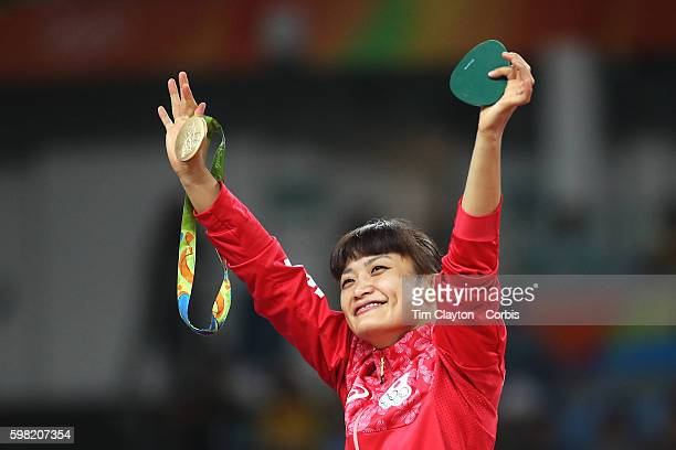 Day 12 Kaori Icho of Japan with her gold medal after victory against Valeriia Koblova Zholobova of Russia during their Women's Freestyle 58 kg Gold...