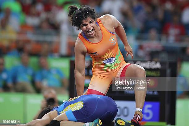 Day 12 Sakshi Malik of India celebrates victory against Aisuluu Tynybekova of Kyrgyzstan during their Women's Freestyle 58 kg Bronze Medal Final at...