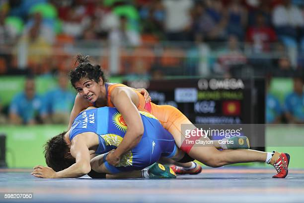 Day 12 Sakshi Malik of India in action during her victory against Aisuluu Tynybekova of Kyrgyzstan during their Women's Freestyle 58 kg Bronze Medal...
