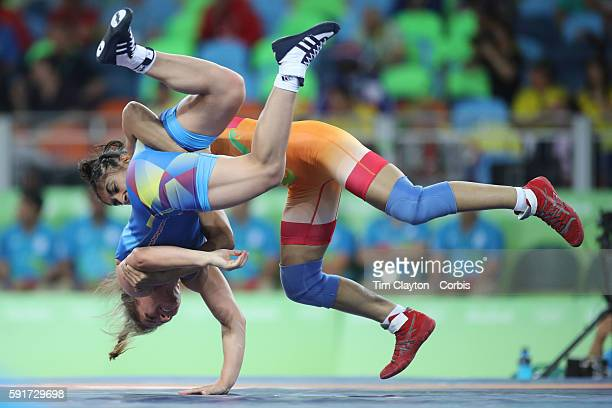 Day 12 Vinesh Vinesh of India throws Emilia Alina Vuc of Romania during their Women's Freestyle 48 kg bout at the Carioca Arena 2 on August 17 2016...
