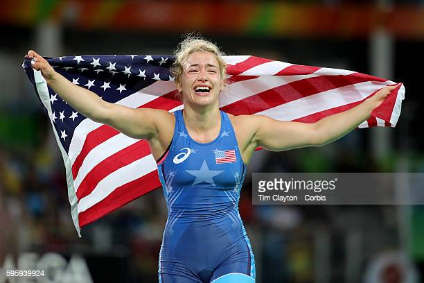 Day 13 Helen Louise Maroulis of the United States celebrates with the United States flag after winning the Gold Medal against Saori Yoshida of Japan...