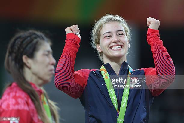 Day 13 Helen Louise Maroulis of the United States reacts with joy after receiving her Gold Medal as silver medalist Saori Yoshida of Japan is...