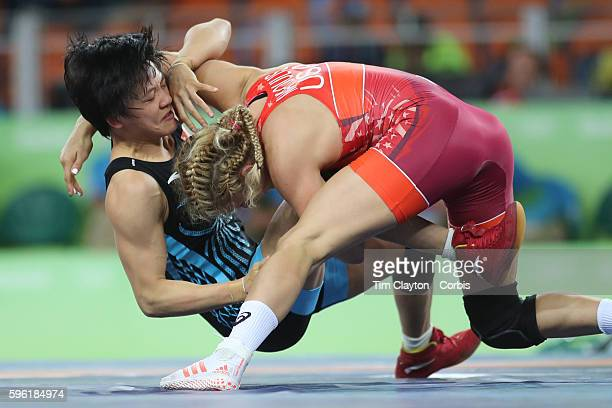 Day 13 Helen Louise Maroulis of the United States defeating Xuechun Zhong of China in the Women's Freestyle 53 kg 1/8 Finals Wrestling match at the...