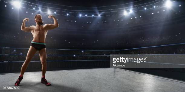 wrestling show. wrestler in a bright sport clothes and face mask in the ring - wrestling stock pictures, royalty-free photos & images