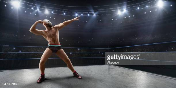 wrestling show. wrestler in a bright sport clothes and face mask in the ring - fighting ring stock pictures, royalty-free photos & images