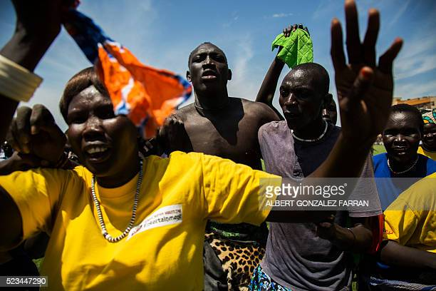 Wrestling supporters from Jonglei cheers and embrace one of their wrestlers after he beat his opponent from Terekeka in the final match of the South...
