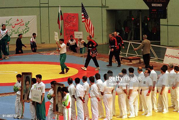 A US wrestling team arrive at the opening ceremony of the Takhti Cup in Tehran 17th February 1998 They are holding their national flag while the...