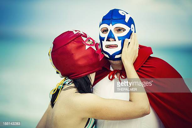 lucha libre tenderness - freaky couples stock photos and pictures