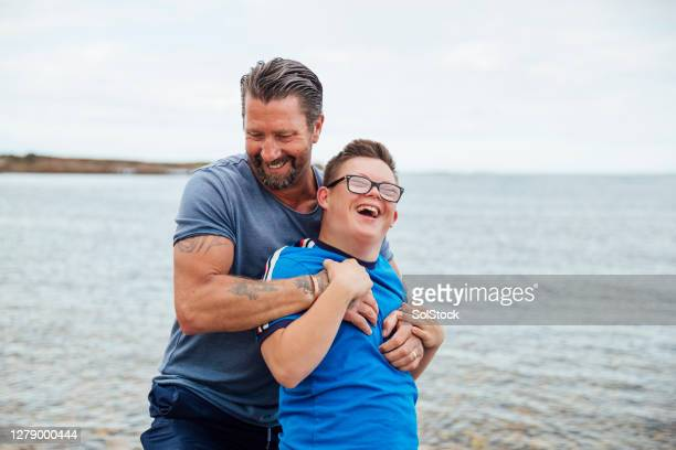 wrestling with dad - real people stock pictures, royalty-free photos & images
