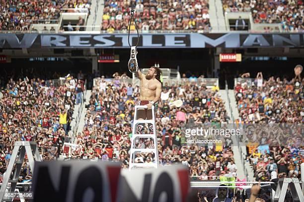 WrestleMania 31: Daniel Bryan victorious on ladder with belt during event at Levi's Stadium. Santa Clara, CA 3/29/2015 CREDIT: Jed Jacobsohn