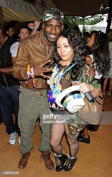 Wretch 32 and Mutya Buena attend the Mahiki Coconut Backstage Bar during day 1 of V Festival 2013 at Hylands Park on August 17 2013 in Chelmsford...