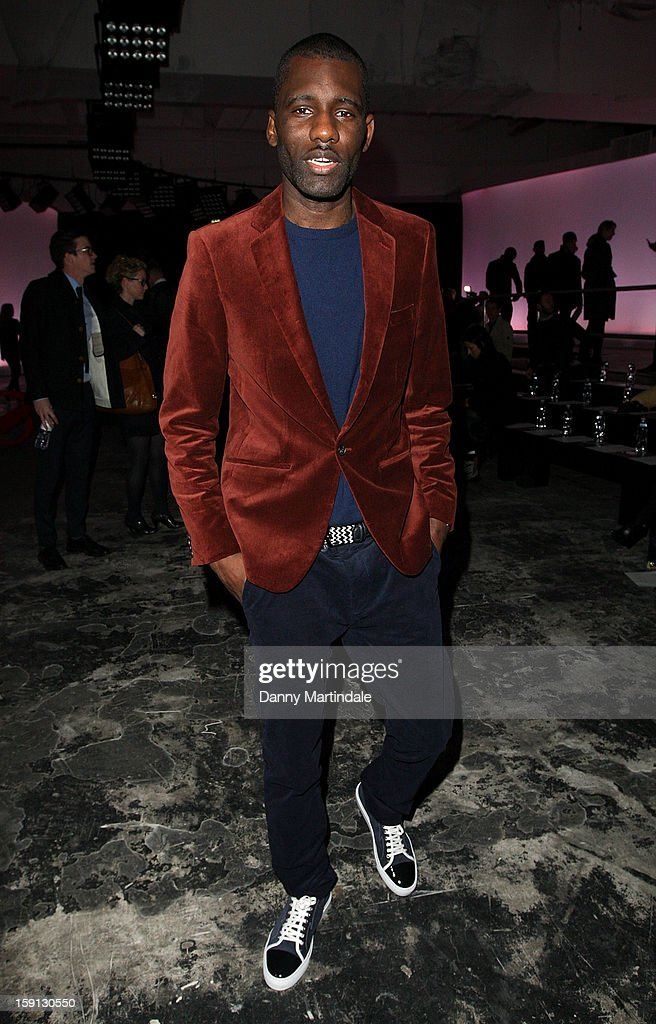 Wretch 32 attends the Oliver Spencer show at the London Collections: MEN AW13 at The Old Sorting Office on January 8, 2013 in London, England.
