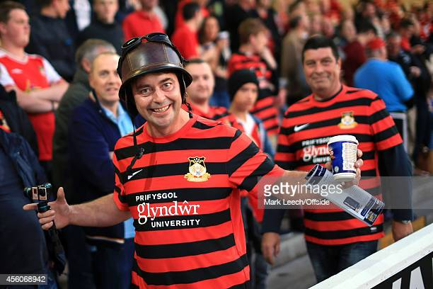 Wrexham fan wearing a leather helmet arrives for the Vanarama Conference match between Chester and Wrexham at the Deva Stadium on September 22, 2014...
