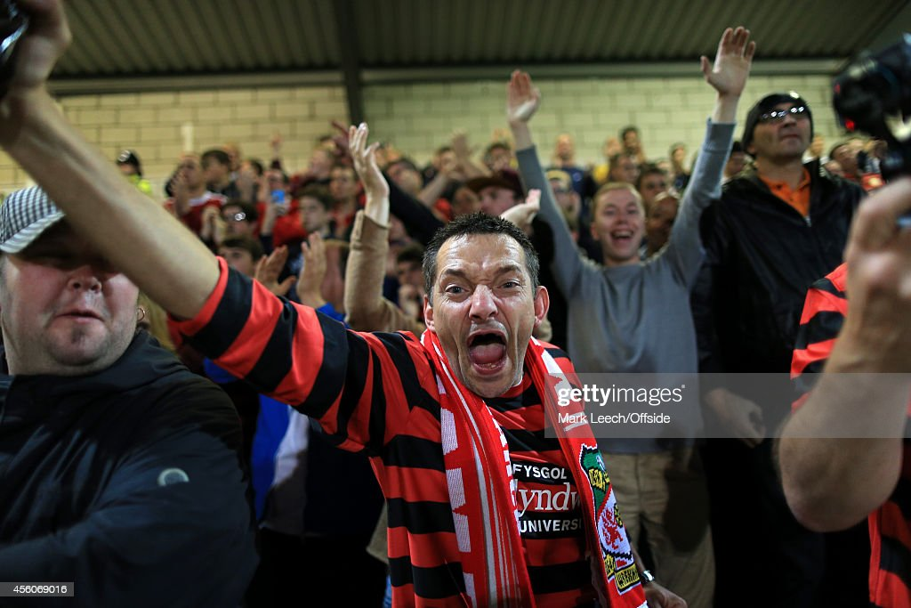 Wrexham fans show their support during the Vanarama Conference match between Chester and Wrexham at the Deva Stadium on September 22, 2014 in Chester, England.