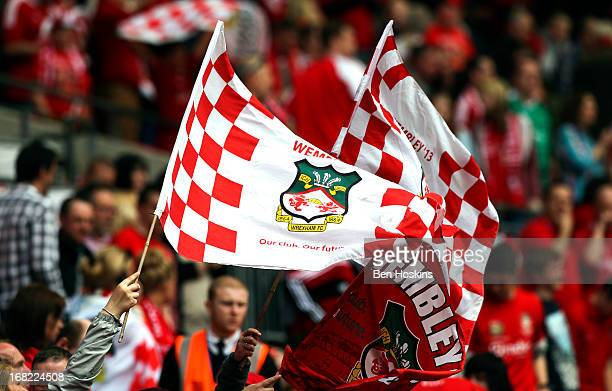 Wrexham fans wave flags during the Blue Square Bet Premier Conference Playoff Final match between Wrexham and Newport County AFC at Wembley Stadium...