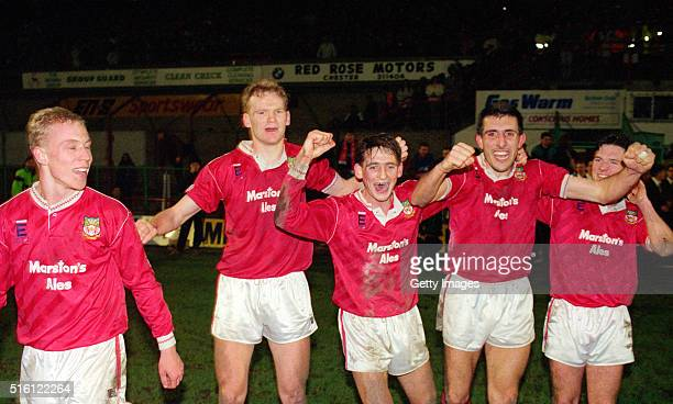 Wrexham goalscorer Steve Watkin and team mates celebrate on the pitch after League Division Four side Wrexham had beaten Division One side Arsenal...