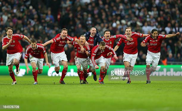 Wrexham players celebrate after a penalty shoot during the FA Trophy Final match between Wrexham and Grimsby Town at Wembley Stadium on March 24,...