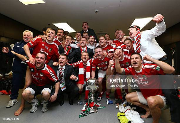 Wrexham players celebrate in their changing room after winning the FA Trophy Final between Wrexham and Grimsby Town at Wembley Stadium on March 24,...