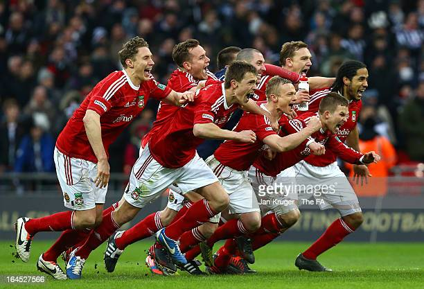 Wrexham players celebrate victory after a penalty shoot out during the FA Trophy Final between Wrexham and Grimsby Town at Wembley Stadium on March...