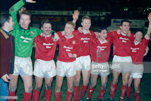 Wrexham players including goalkeeper Vince O'Keefe Gordon Davies goalscorer Steve Watkin and Brian Carey celebrate victory in the FA Cup 3rd Round...
