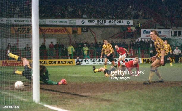Wrexham striker Steve Watkin scores the winning goal past David Seaman watched by left to right David O' Leary Tony Adams Gordon Davies and Lee Dixon...