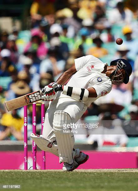 Wriddhiman Saha of India ducks under a high delivery from Mitchell Starc of Australia during day four of the Fourth Test match between Australia and...
