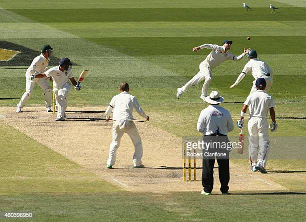 Wriddhiman Saha of India is caught by David Warner of Australia during day five of the First Test match between Australia and India at Adelaide Oval...